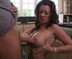 The son fucks his mother's big slut in the kitchen