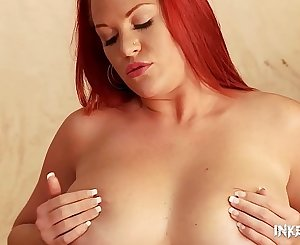 Tattooed porn model Paige Delight shakes big tits while fingering her pink