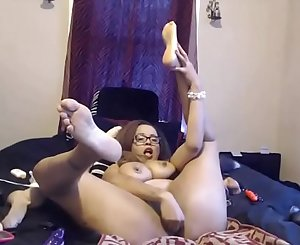 Inked ebony MILF with glasses and enormous pierced boobs